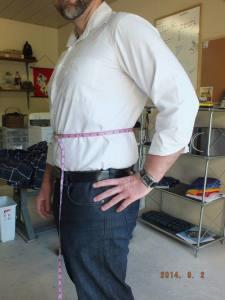 Measuring around the waist.